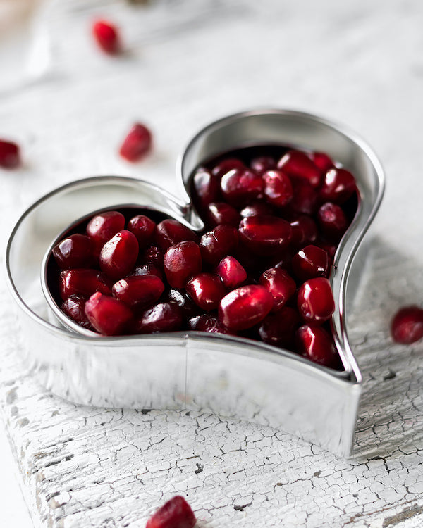 pomegranate arils in heart shaped cookie cutter