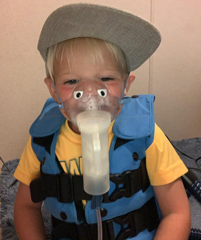 Tanner going through one of his daily treatment sessions to combat Cystic Fibrosis.