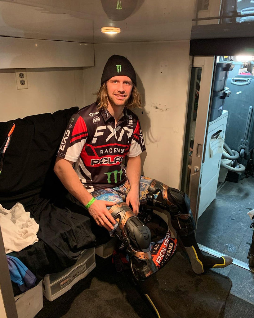 Kody Kamm suiting up for Snocross with his Axis Pro Knee Braces.