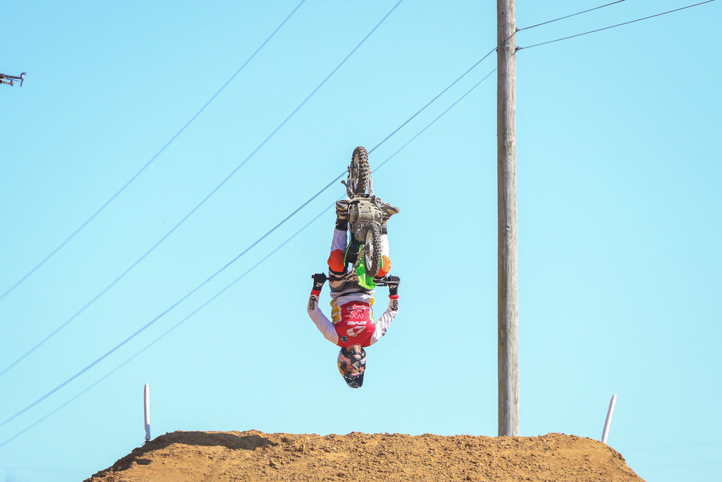 Travis Pastrana mid backflip during the 'Almost' Straight Rhythm event at the Bluegrass Brawl