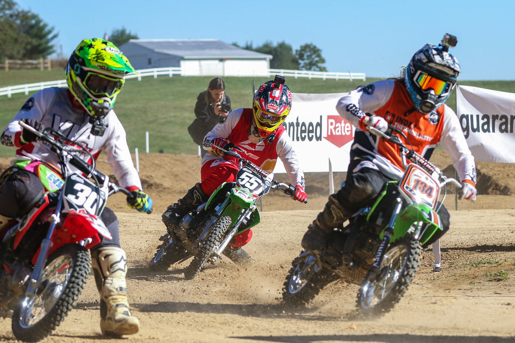 Smagical, AJ Catanzaro and TroySmallz duking it out in a heat race during Flat Track at the Bluegrass Brawl.