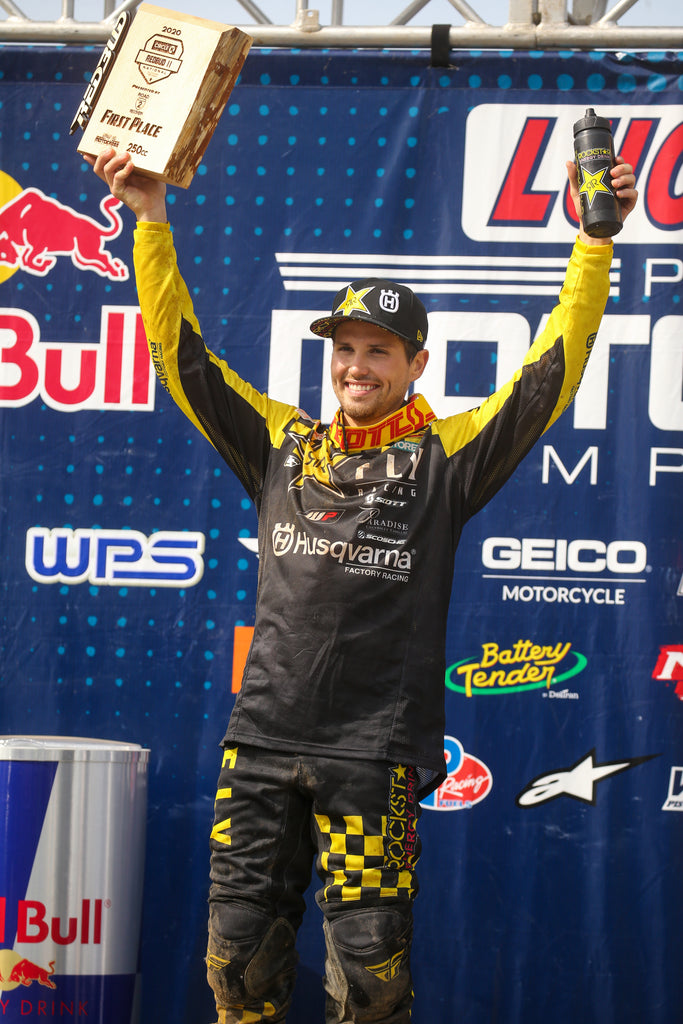 RJ Hampshire celebrating on the podium after taking the win at Red Bud 2!