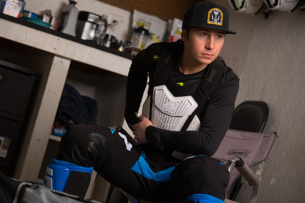 Joey Crown gearing up with his EVS protection gear prepping for the Lucas Oil Pro Motocross Championship