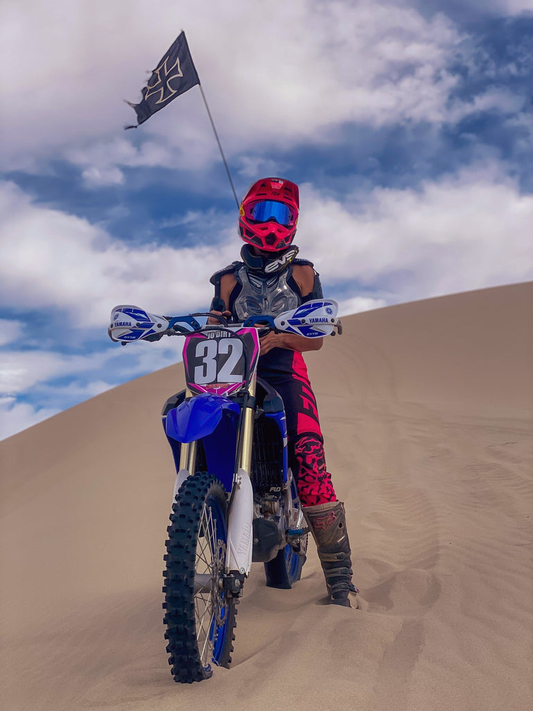 Jodi Snider eyeing down the dunes geared up and ready to go with her EVS Race Collar!