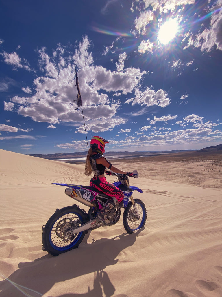 Jodi Snider geared up and ready to rip in the dunes with her EVS Race Collar!