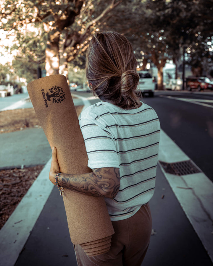 Yogini carrying NZ designed yoga mat