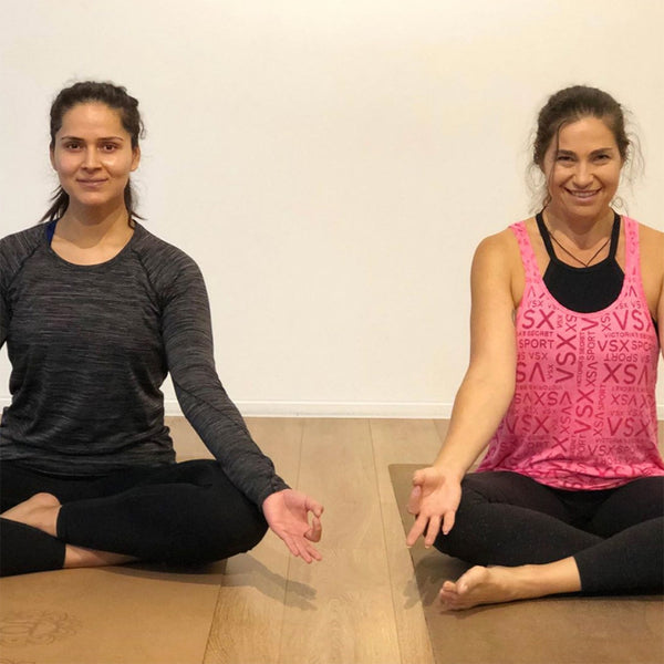 Ally Cohen and Mani on their Cork Yoga Mats