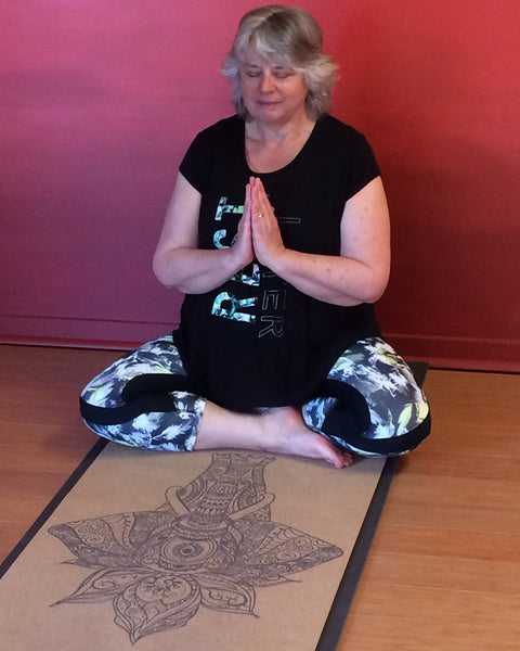 Yoga Teacher Sheila Kennard meditating on Elephant Cork Yoga Mat