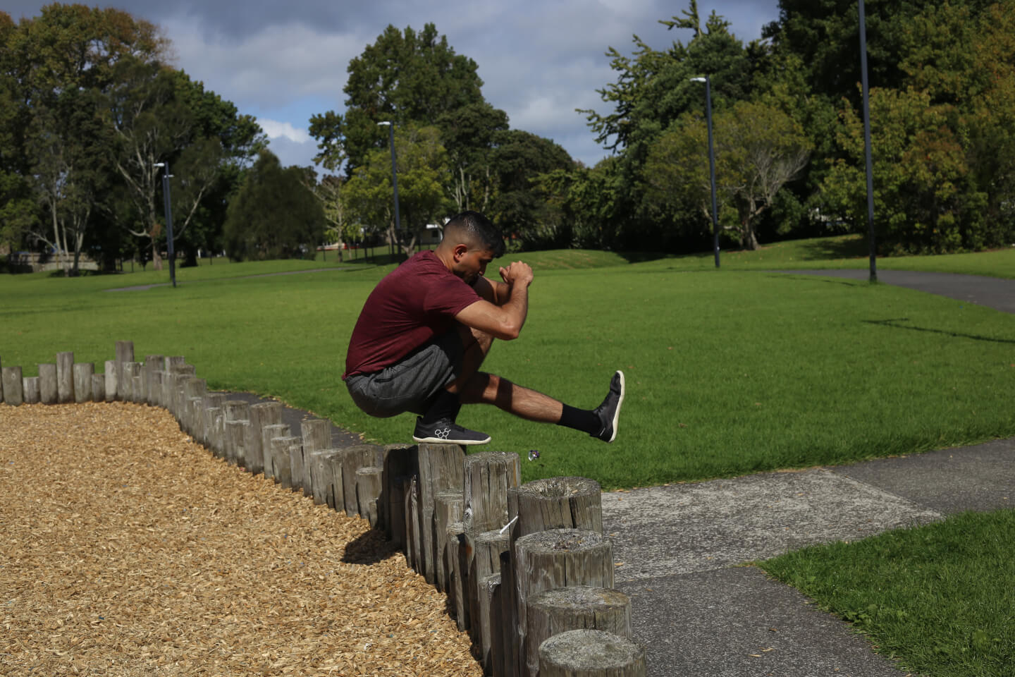 The Lifestyle PT demonstrating a pistol squat on an elevated