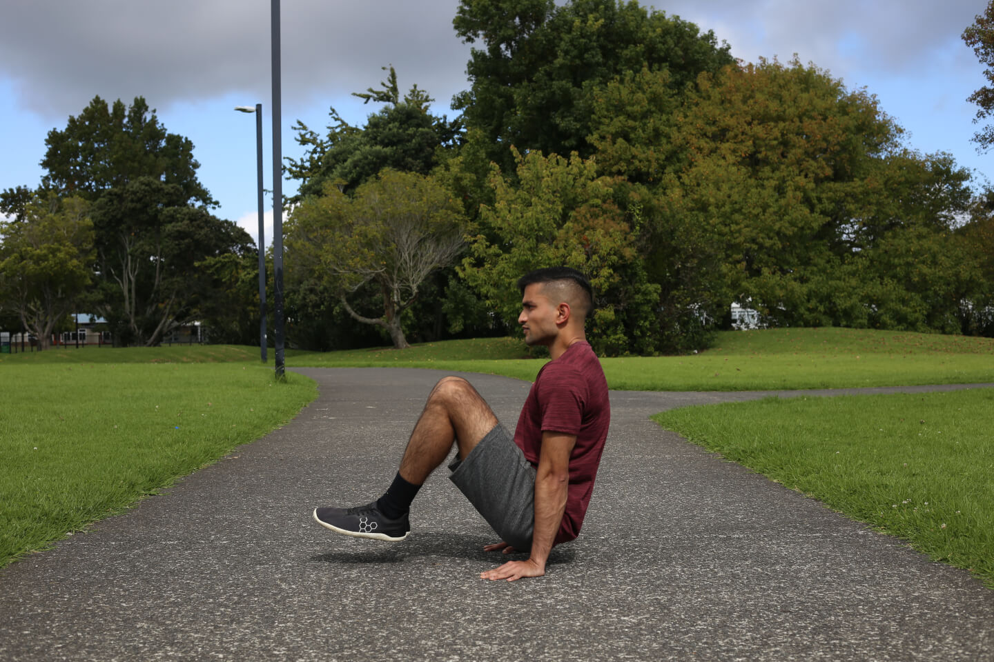 Dinesh demonstrating a tuck L sit