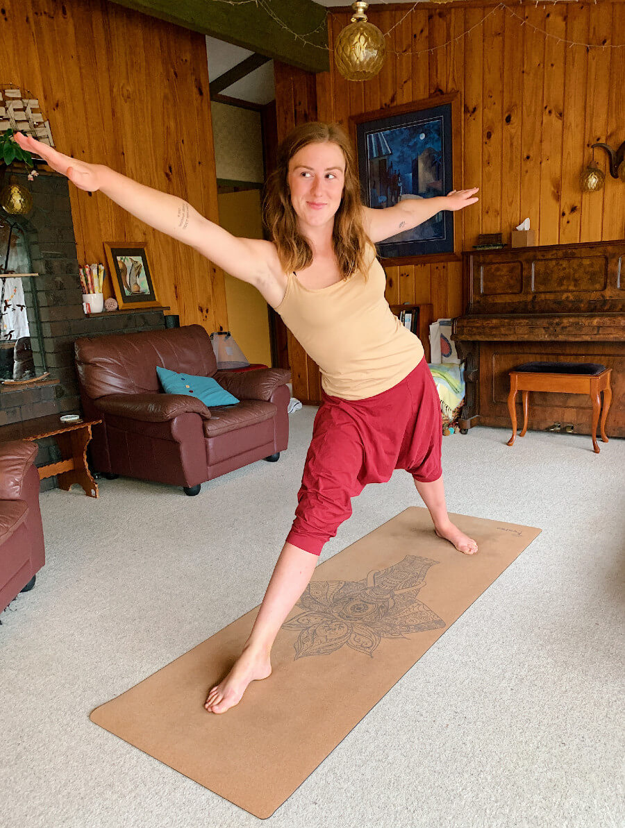 Ethically Kate practicing on her yoga mat