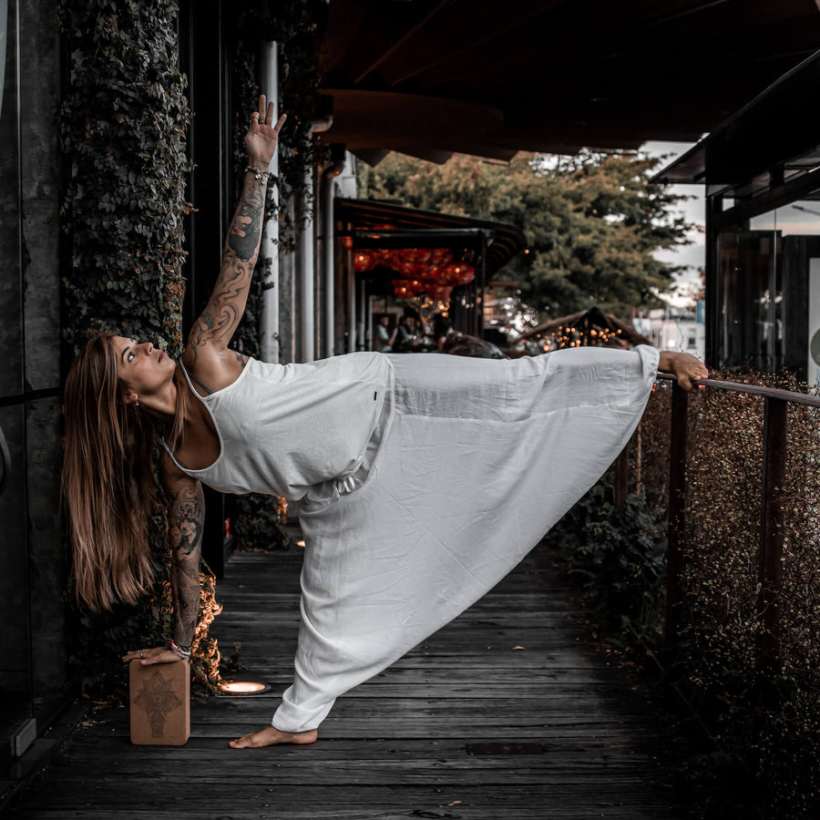 Woman using cork yoga block for support in Auckland New Zealand