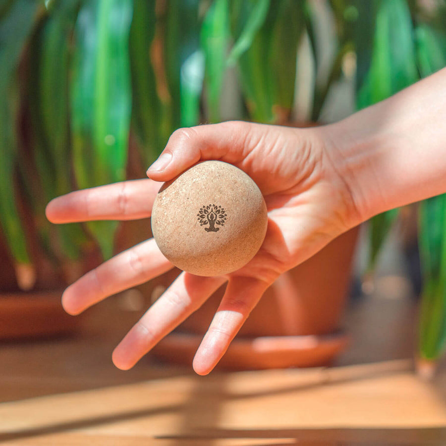 Cork massage ball in hand