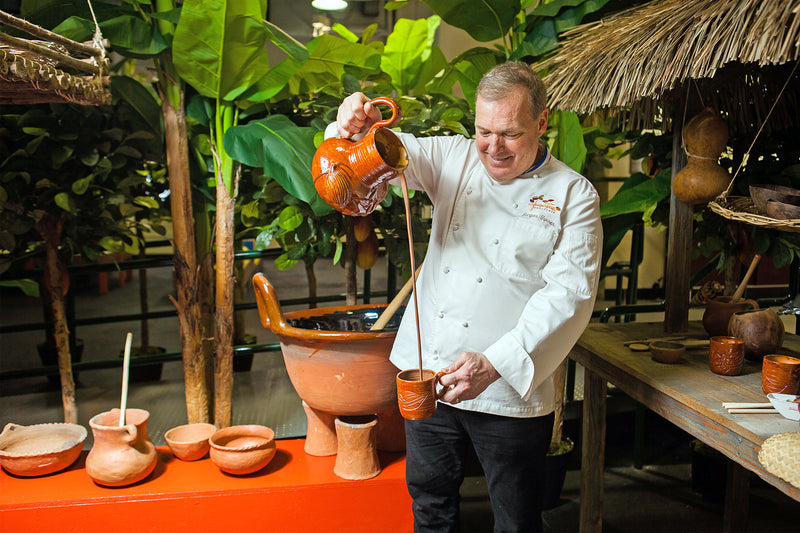Chef Jacques Torres pours melted hot chocolate at the Choco-Story Museum