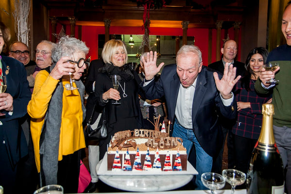 Chef Alain Sailhac Blows out the candles on his 80th Birthday Cake