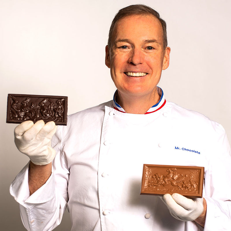 Chef Jacques Torres holding milk and dark chocolate Easter bars