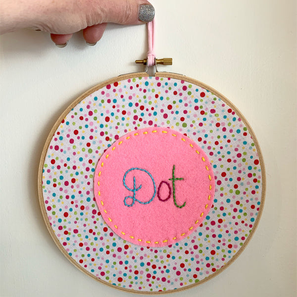 Embroidered name hoop wall hanging