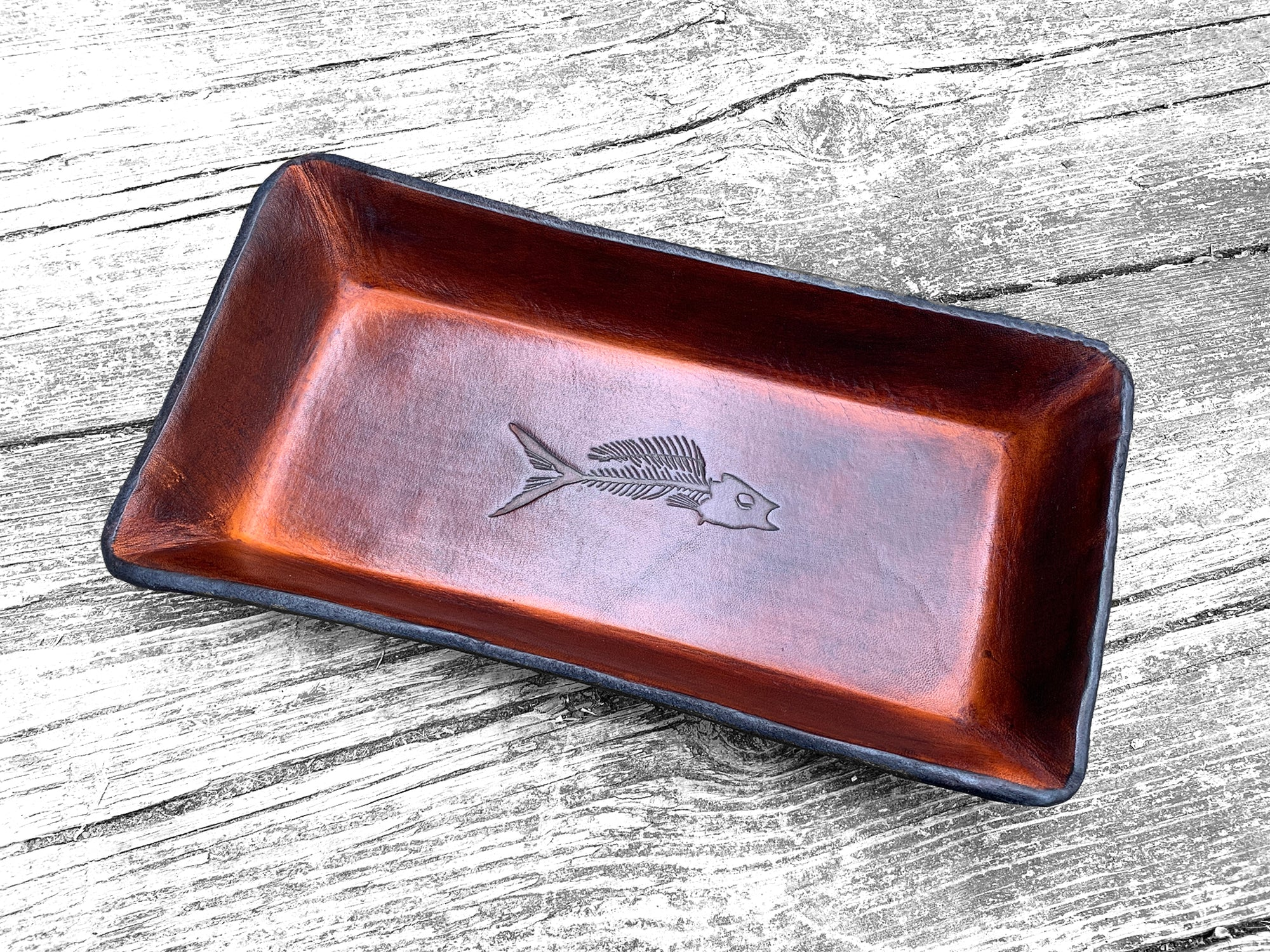 Our Leather Valet with Fossil Fish Motif Makes a Rustic Statement