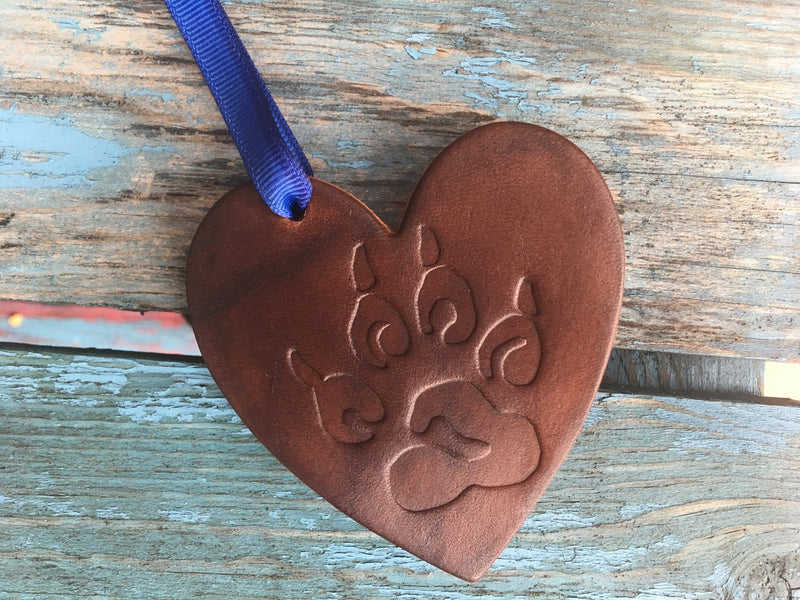 Leather heart Christmas ornament with paw print.