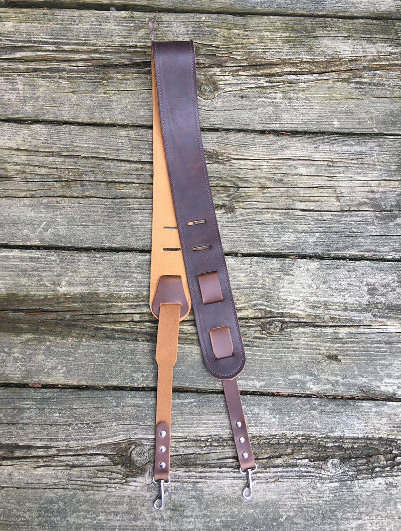 Leather and suede banjo strap with clip attachment.