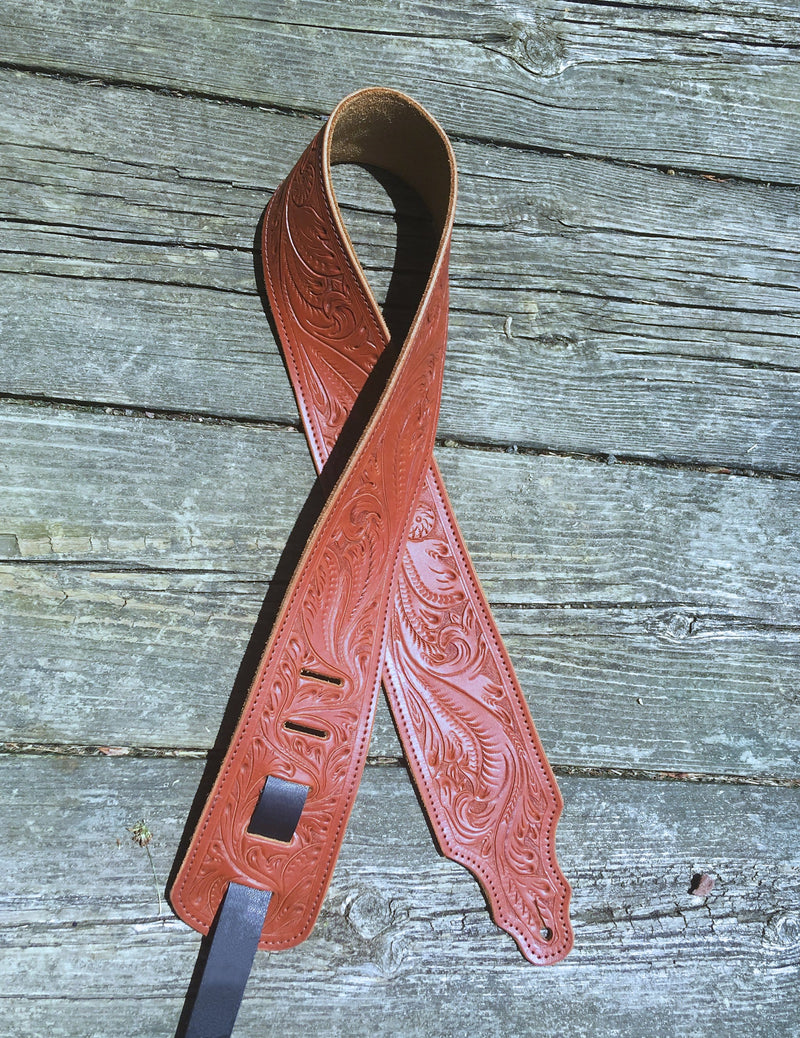 Western tooled leather guitar strap. Chestnut and black.