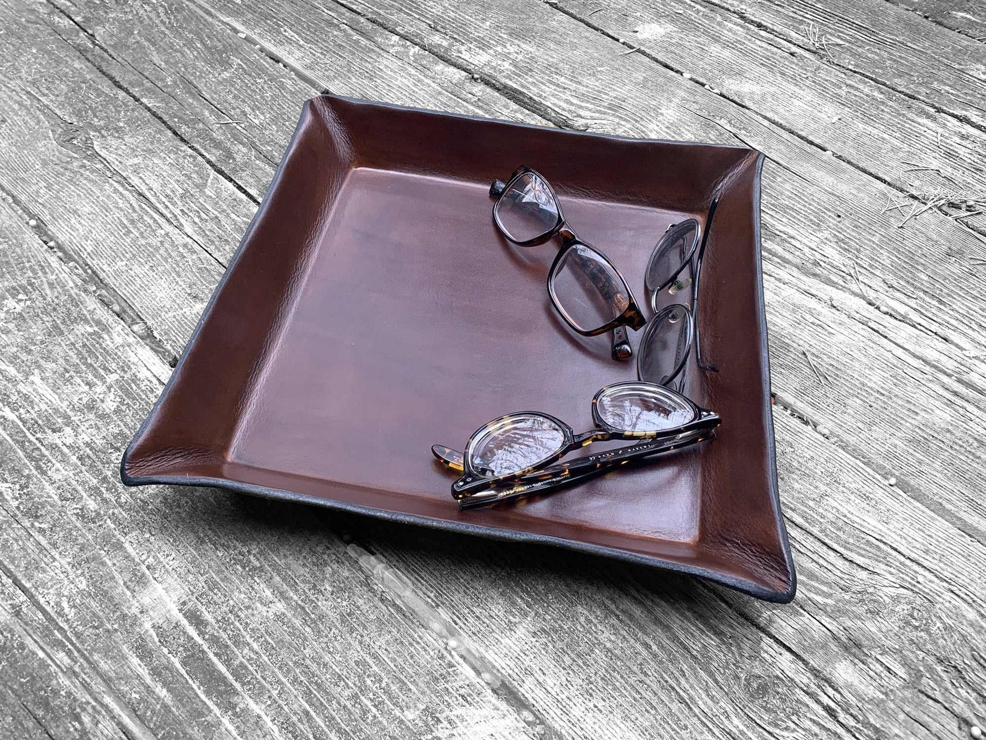 Large, square leather valet tray.