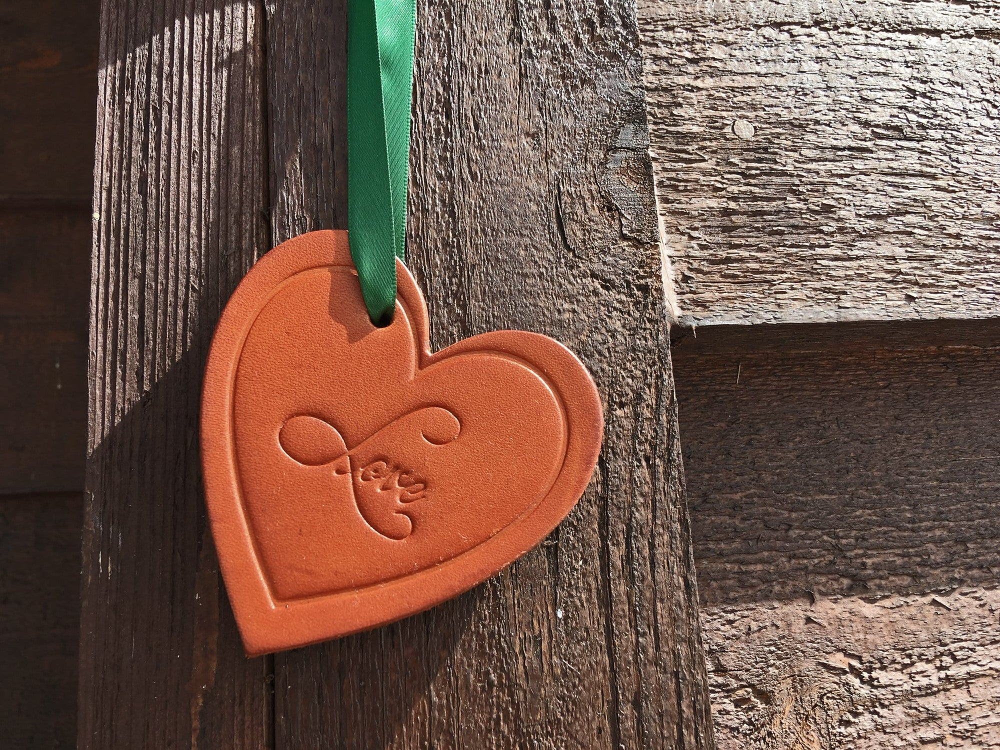 3rd anniversary gift leather heart ornament.