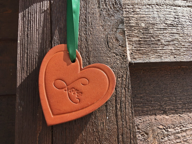 Third anniversary gift leather heart ornament.