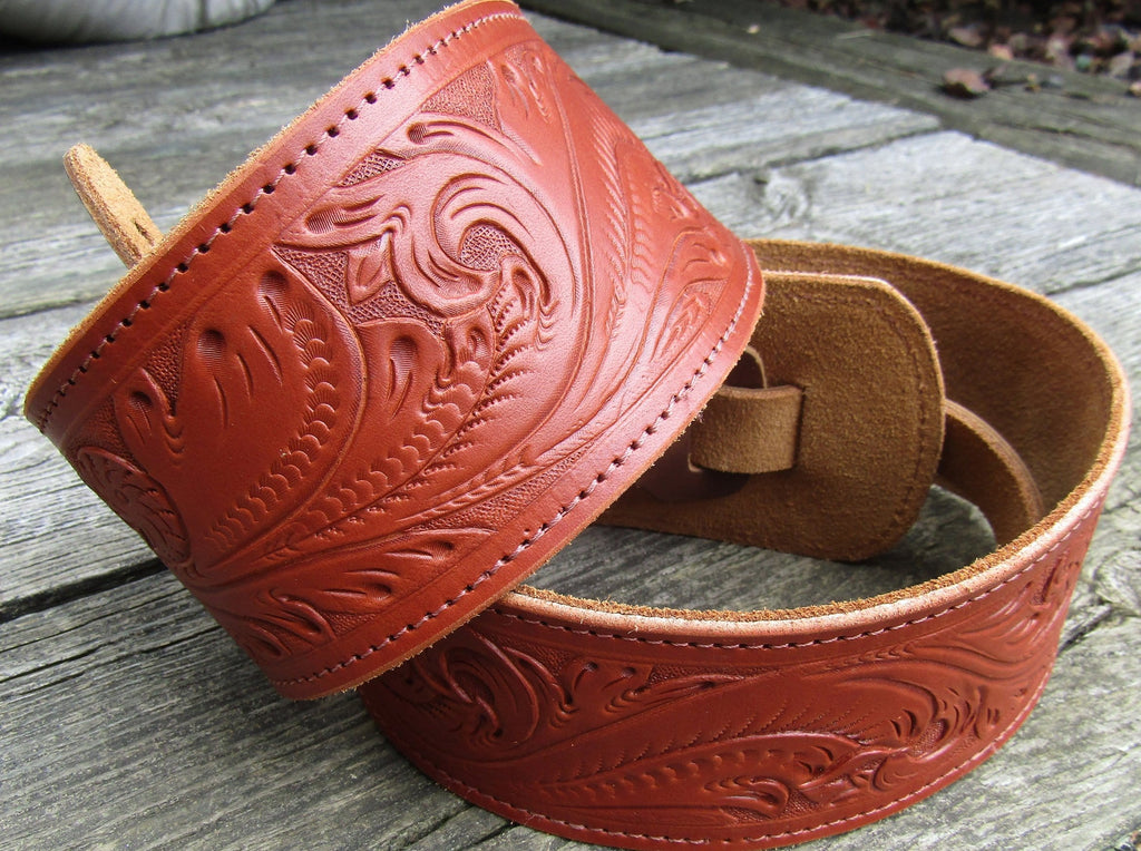 Chestnut leather Western tooled guitar strap.