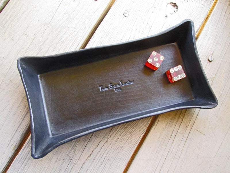 Black leather valet tray. Twin Saints Leather logo.