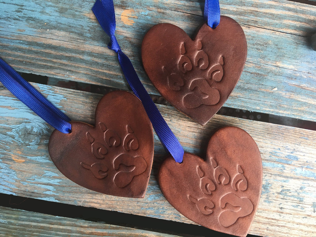 Brown leather ornaments with embossed paw print.