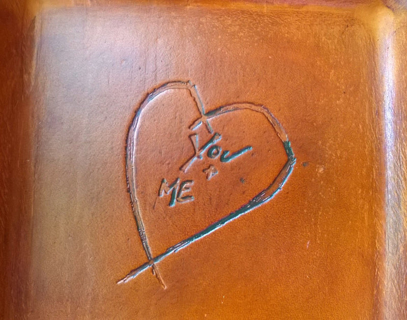 Detail of distressed heart leather tray.