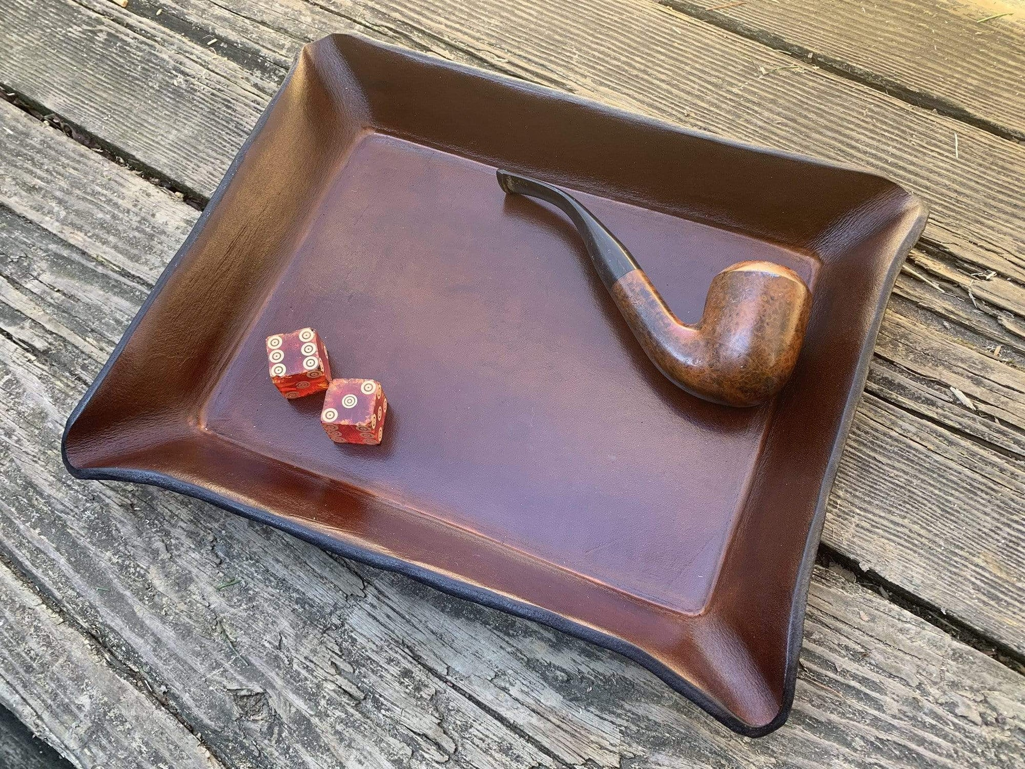 Leather valet tray for pipe display.