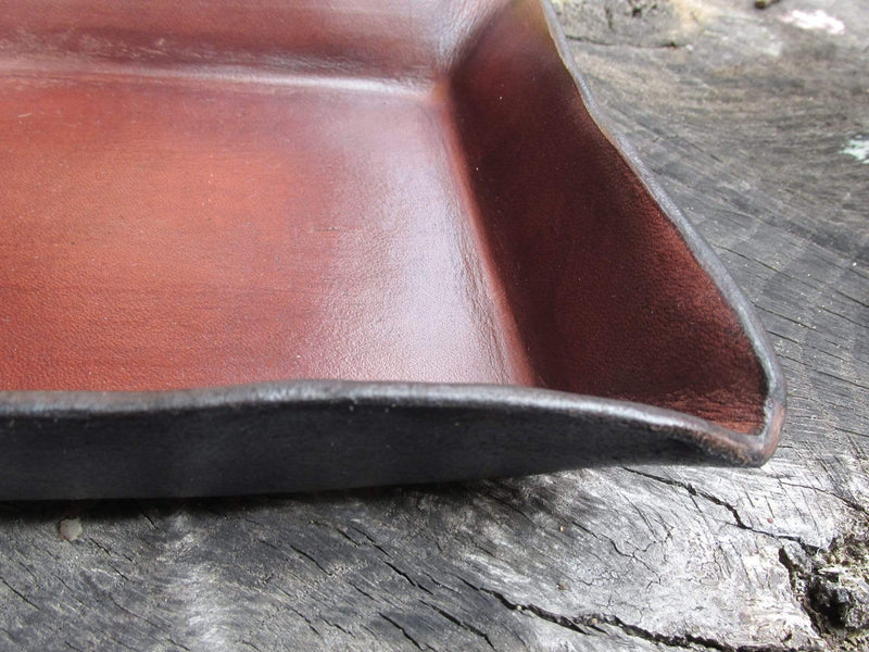 Detail of brown leather desk valet tray