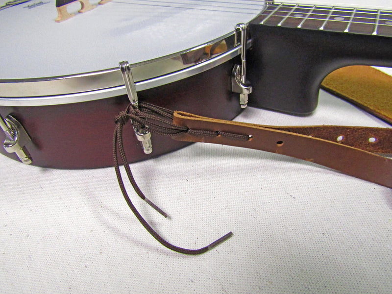 Banjo strap attachment for banjo without resonator.