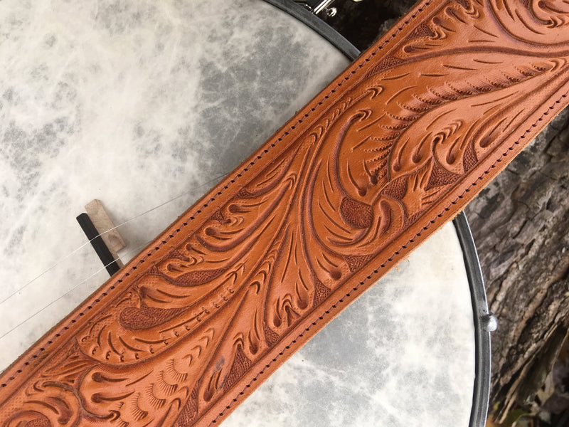 Close-up of hand tooling on Antonia leather banjo strap.