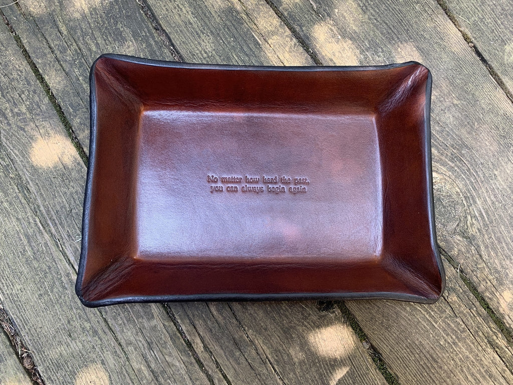 No Matter How Hard the Past, You Can Always Begin Again leather valet tray.