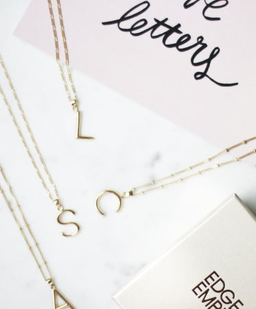 Initial charm necklaces