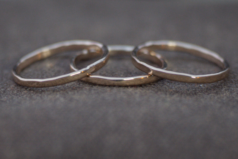Closeup of yellow gold stacking rings