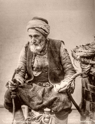 Turkish farmer smoking the water-pipe . A photograph taken by Sébah & Joaillier, photographers of the Sultan in Konstantinopel / Istanbul.