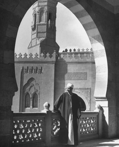 Photo: Vice Dean of faculty of theology looking out over the balcony. Photograph by John Phillips. Cairo, Egypt, June 1947.