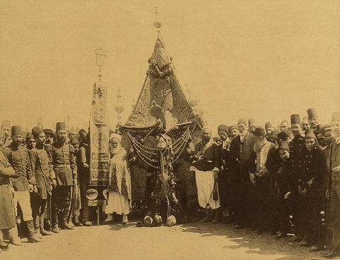 ca. 1903, December 14. Soldiers and dignitaries after leaving Damascus, Syria, for the Hajj seen carrying the Mahmal (the Holy Carpet) or the emblem of the Ottoman Emperor.