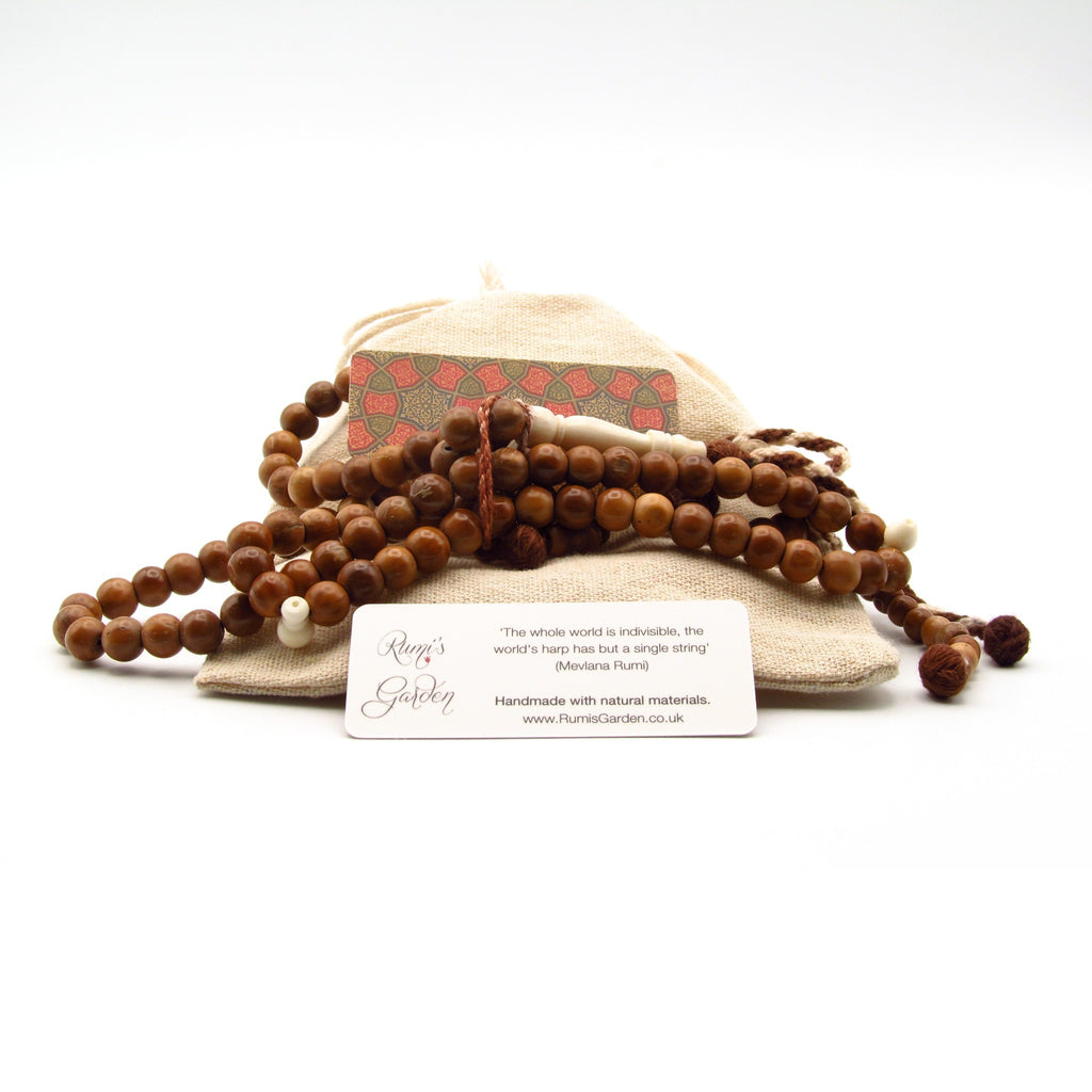 Coquille Nut Tasbih with camel bone alif for sale