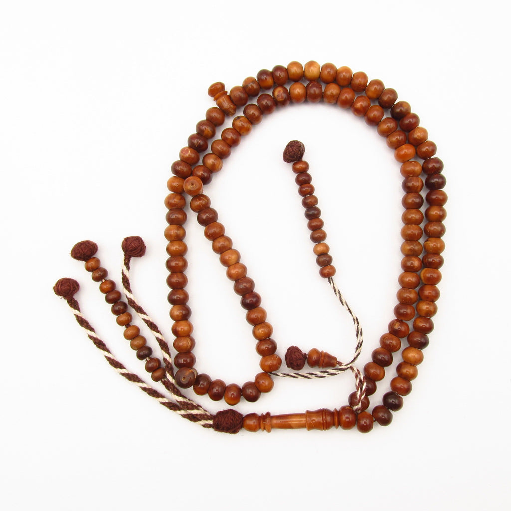 medium round bead coquilla nut rosary