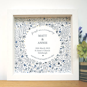 First anniversary gift personalised with couples names, date of marriage, place and town of wedding. With gold foil details