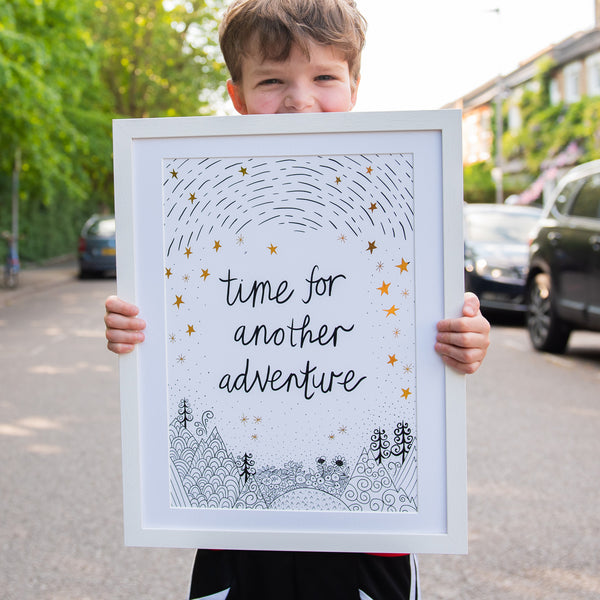 antdesigngifts.co.uk B&W and gold art print with the quote 'time for another adventure' with a hand drawn illustration of mountains, trees, sky and stars. Nursery wall art and art for childs bedroom