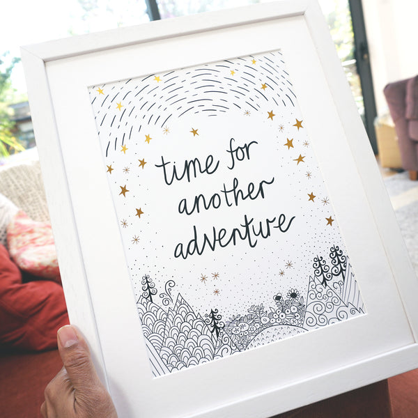 antdesigngifts.co.uk Black and white and gold art print with the quote 'time for another adventure' with a hand drawn illustration of mountains, trees, sky and stars