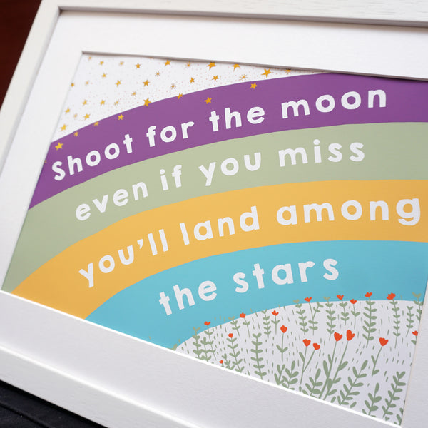 Close up of Shoot for the moon land among the stars rainbow print with gold foil stars