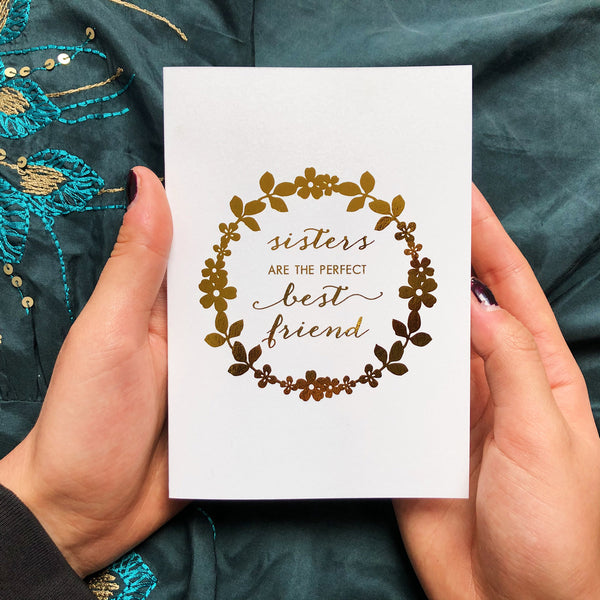 Sisters are the perfect best friend. Gold Foil greeting card in white. With white or gold envelope.