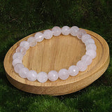 Pale Rose Quartz Healing Bracelet on Wood